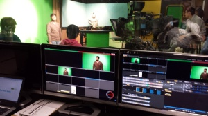World Seminar students shoot a segment called the World Report in the PNN Studio.